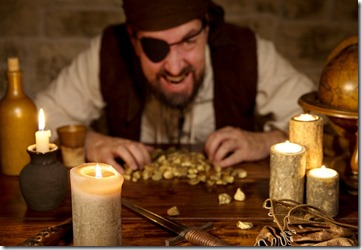 Pirate With A Treasure Of Gold Behind A Lot Of Candles